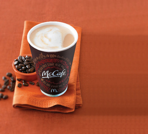 McCafe invites coffee drinkers across the U.S. to stop by their local participating McDonald's restaurant for a freshly brewed small McCafe coffee during McDonald's first-ever national Free Coffee Event.  Free McCafe coffee is available during breakfast hours starting March 31 through April 13 in participating restaurants.  (PRNewsFoto/McDonald's)