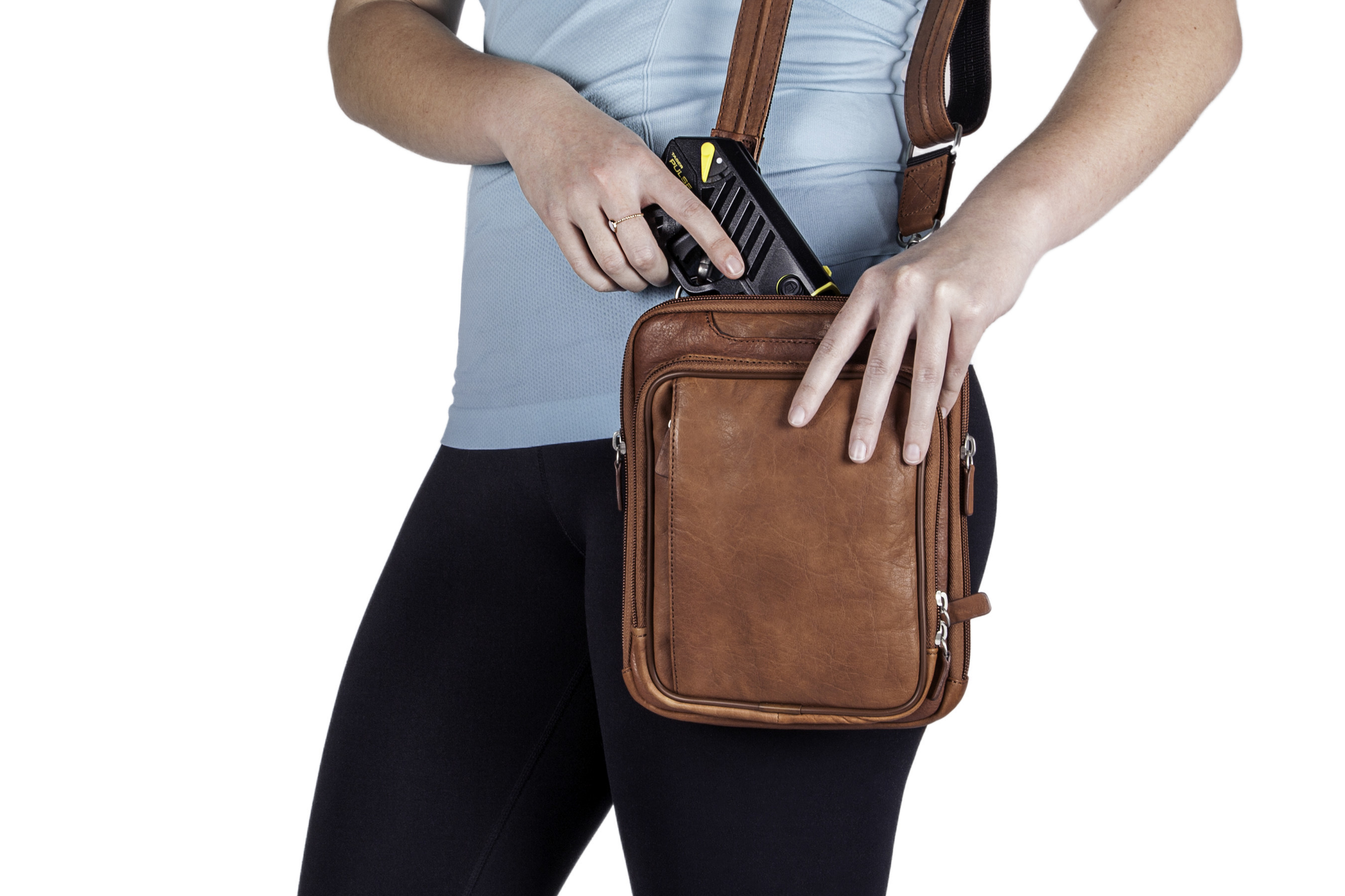 The new TASER Pulse conducted electrical weapon for consumers is the smallest TASER weapon ever made and fits easily in a purse.