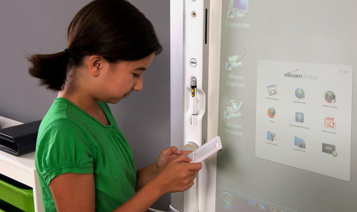 A student uses the wireless keyboard from eBeam Engage, the world's first interactive multimedia console ...