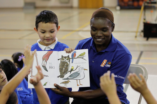 WNBA legend Marie Ferdinand Harris reads to students during the WNBA Cares Team. Works. In Schools event ...