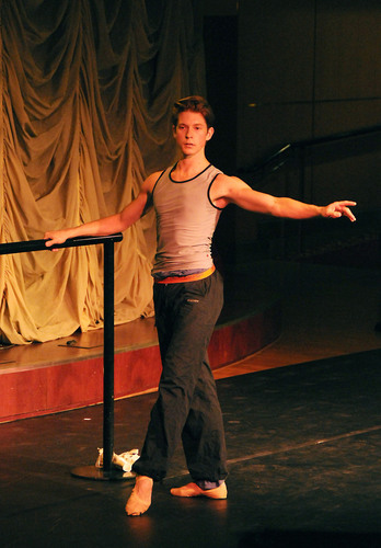 "Ballet dancer Charlie Anderson ""warms up"" during one of Crystal's Master Classes at Sea, offered during their ""Emerging Artists"" theme cruises.  (PRNewsFoto/Crystal Cruises)"