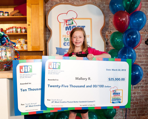 Mallory R., age 8 from Hilton Head Island, SC, was named the grand prize winner in the Tenth Annual Jif Most Creative Peanut Butter Sandwich Contest(TM) on March 22, 2012 in New York City. She was presented with a check for a $25,000 college fund, plus a check for an additional $10,000 for educational products. For the winning recipe, P-Nutty BBQ Chicken Quesadilla, visit www.jif.com.  (PRNewsFoto/The J.M. Smucker Company)