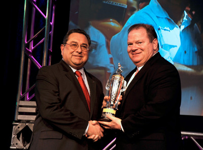 BorgWarner Executive Chairman Timothy M. Manganello presented the BorgWarner Championship Team Owner's Trophy(TM) to team owner Chip Ganassi to recognize his 2012 Indianapolis 500 victory.  Photo courtesy of Patrick Bafile, P.B. Photographics.  (PRNewsFoto/BorgWarner Inc.)