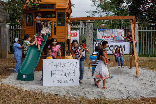 Children of a Filipino orphanage enjoy a brand new playground on Christmas Day. It was made possible by a generous donation from Reagan Wireless, a leading technology company in the global cellular phone distribution industry, headquartered in Deerfield Beach, Florida. (PRNewsFoto/Reagan Wireless) (PRNewsFoto/REAGAN WIRELESS)