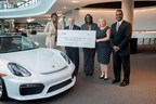 Left to right, Latanza Adjei, vice president of sales for Georgia Power and Tim Quinn, vice president of AfterSales for Porsche Cars North America, are joined by Lisa Smith, Glenda Draper and Carl Jackson from Georgia Power at Porsche Cars North America, Inc. for workplace charging rebate presentation.