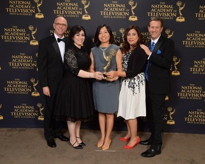 "'Full Frame' Team of China Central Television America received EMMY Award for ""outstanding magazine feature"" in New York. Left to right: Ira Lazernik - Director;  Monna Kashfi - Full Frame Executive Producer ; Mei Yan - CCTV America Managing Editor; Sahar Sarshar - Segment Producer;  Mike Walter - Full Frame host."