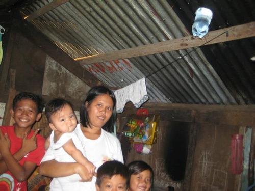 Solar light bottle installation in Anda, Bohol, The Philippines. (PRNewsFoto/Andakidz) (PRNewsFoto/ANDAKIDZ)
