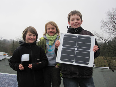 Kids at the Ostseeschule Flensburg proudly presenting solar products for Africa.  (PRNewsFoto/Yingli Green Energy Holding Company Limited)