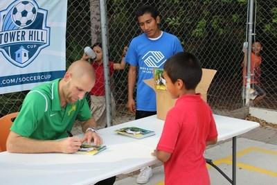 Tampa Bay Rowdies player Keith Savage signs autographs at the Bonita Springs soccer clinic.