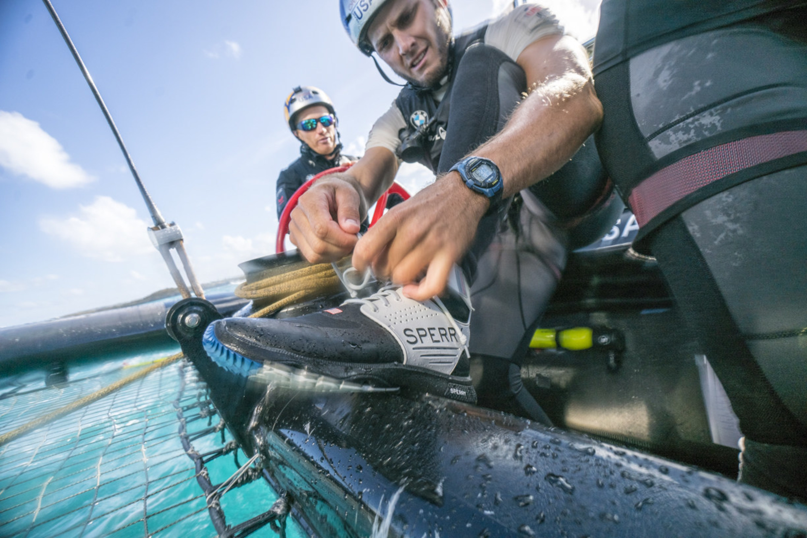 ORACLE TEAM USA athlete TJ Johnson laces up the new Sperry 7 SEAS Pro shoe before racing Photo Credit: Sam Greenfield