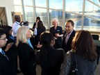 President and CEO Oscar Munoz speaking with a group of United employees in front of glass window