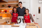 From left to right: mom Debra Humphries, NBA star Kris Humphries, and *Taste of Home* editor-in-chief Catherine Cassidy bake holiday cookies in preparation for an appearance on ABC's Good Morning America tomorrow, as Humphries enters a new chapter in his life.  The Humphries, long-time fans of *Taste of Home*, the No. 1 magazine for cooking and entertaining, will appear with Cassidy for a Christmas segment to share their favorite family holiday cookie recipe, which can be found with other holiday cookie recipes at TasteofHome.com.  (PRNewsFoto/Taste of Home)