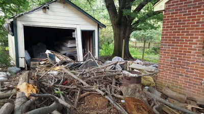 This photo was taken in April 2016 and shows a foreclosure in an African American neighborhood in Memphis, TN, with significant debris left in the yard by Bank of America.  This property is a health and safety hazard for people living nearby.