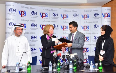 Ms. Madeline Bell, President & CEO of Children's Hospital of Philadelphia (CHOP) and Dr. Shamsheer Vayalil, Founder & Managing Director of VPS Healthcare exchange contracts after signing strategic partnership. Seen in the picture are Dr. Ali Obaid Al Ali, CEO of Abu Dhabi Hospitals at VPS (extreme left) and Dr. Ibtesam Al Bastaki, Director at VPS healthcare (right) (PRNewsFoto/VPS Healthcare) (PRNewsFoto/VPS Healthcare)