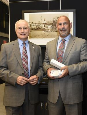Pictured left to right: James Brodrick, Lighting Program Manager, US Department of Energy, Building Technologies Program, with Chuck Campagna, Amerlux CEO and President.