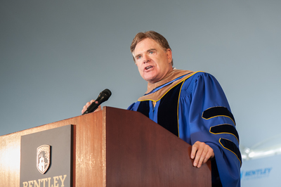 Chairman of the Board, TD Ameritrade and Coastal Carolina University Head Football Coach Joe Moglia delivers the commencement address to approximately 1,000 Bentley University undergraduate students at the 95th Commencement ceremony on May 17, 2014. (PRNewsFoto/Bentley University)