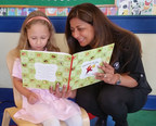 Primrose Schools Franchise Owner, Pratiksha Rigley, reads to Primrose student, Zoey Clark, at Primrose School of Plano at Deerfield outside of Plano, Texas.