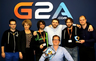 The G2A Team with the Gaming for Good Team at G2A Headquarters recently.From left:  Tomasz Guzek,  Jacqueline Purcell, Bachir 'Athene' Boumaazaa, Dawid Rozek, Reese Leysen, Karol Jacewicz, Bob Voermans (kneeling) (PRNewsFoto/G2A.com)