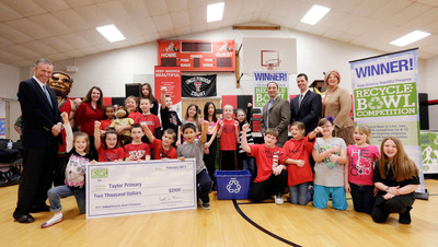 Keep America Beautiful president Matt McKenna, left, poses with children and dignitaries after presenting a check to Taylor Primary School, the winner of Recyle-Bowl, Keep America Beautiful's national K-12 recycling competition, in Kokomo, Ind., Wednesday, Feb. 13, 2013. (AJ Mast /AP Images for Keep America Beautiful).  (PRNewsFoto/Keep America Beautiful)