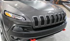 Palmen looks at how the new 2014 Jeep Cherokee stacks up against the Grand Cherokee.  (PRNewsFoto/Palmen Chrysler Dodge Jeep Ram of Racine)