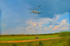 A K-MAX unmanned helicopter delivers an SMSS unmanned ground vehicle during a fully autonomous mission demonstration at Fort Benning, Georgia.  A safety pilot was on board K-MAX but did not operate the controls at any time. (PRNewsFoto/Lockheed Martin)