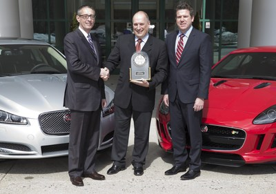 John Csernotta, Executive Director, Global Automotive, J.D. Power (L) presented Joe Eberhardt, President and CEO, Jaguar Land Rover North America (C) and Eric Johnston, Vice President Customer Service, Jaguar Land Rover North America (R) with a 2015 J.D. Power Customer Service Index award recognizing Jaguar as the highest achieving automotive luxury brand in the U.S. for customer satisfaction with retailer service for vehicle maintenance and repair on March 18, 2015.