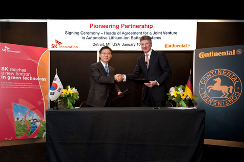 Dr. Jay Koo, CEO of SK Innovation (left) and Dr. Elmar Degenhart, CEO of Continental (right) commemorate the ...