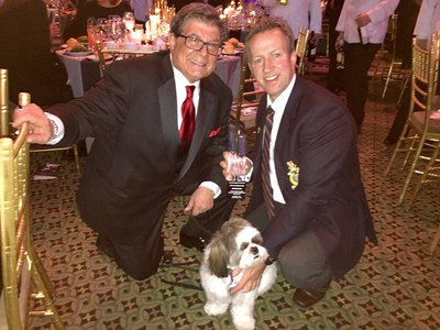 "American Dog Rescue Founder Arthur E. Benjamin, Pen Farthing of Nowzad Dogs and Benjamin's sidekick Bandit pose for a photo at the Humane Society Of The United States' ""To The Rescue! New York"" benefit November 21. Farthing received American Dog Rescue's 2014 Humanitarian Award at the event. Proceeds from the event, held at Cipriani on 42nd Street in New York City, benefit HSUS' ongoing, national animal rescue efforts. Farthing also recently won the 2014 CNN ""Hero of the Year Award."""