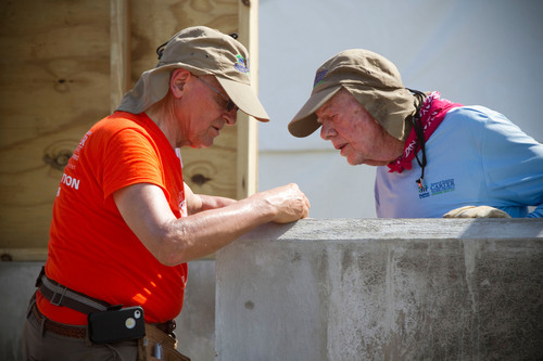 Former U.S. President Jimmy Carter and construction leader LeRoy Troyer are among the nearly 600 volunteers who traveled to Leogane, Haiti, for the 29th annual Jimmy and Rosalynn Carter Work Project.  (PRNewsFoto/Habitat for Humanity International)