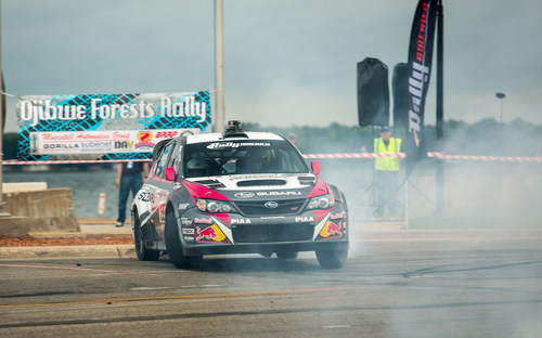 Subaru Rally Team USA driver Travis Pastrana wows fans on the streets of Detroit Lakes, MN the final stage of ...
