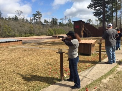 Wounded veterans gather to shoot skeet at range.