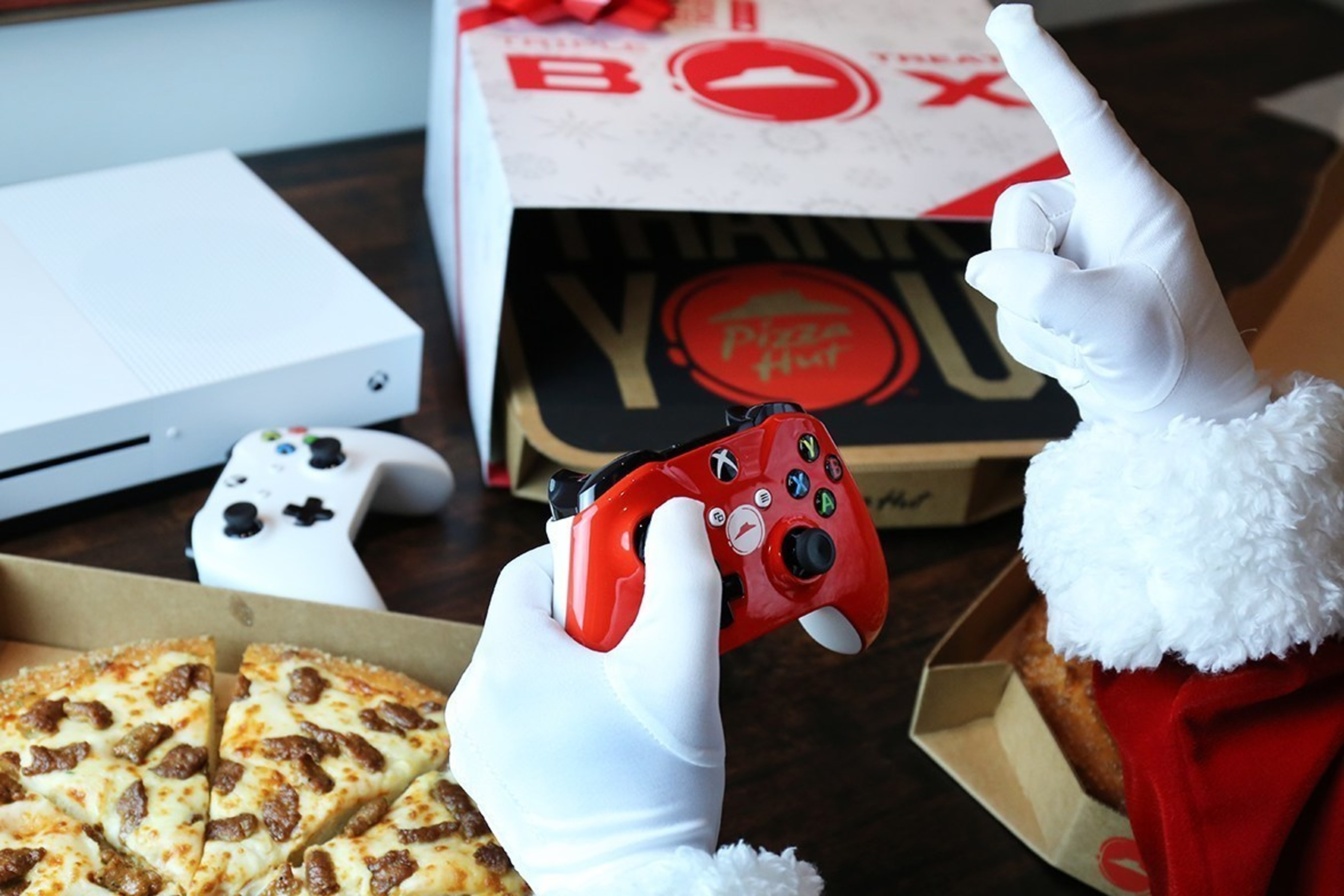 Pizza Hut and Xbox have teamed up to spread holiday cheer by adding a new treat to the Pizza Hut Triple Treat Box - the chance to win an Xbox One S, the ultimate games and 4k entertainment system every hour from Nov. 7 through Dec. 24. That's 1,140 free Xbox One S consoles. Customers will receive an entry code for a chance to win an Xbox One S and custom Pizza Hut designed red controller, as well as an offer for $10 off an Xbox One game with each purchase of a Triple Treat Box while supplies last.