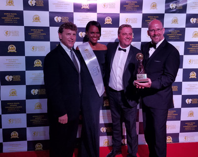 Brad Bennett (far right) and Brian Houser (far left) accept the award for North America's Leading Travel Club on behalf of DreamTrips at the 23rd annual World Travel Awards(TM) presented at the Caribbean & North America Gala Ceremony on Sep. 17 in Ocho Rios, Jamaica.