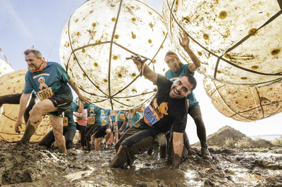 Octavio M. takes on a muddy obstacle at MuckFest MS Los Angeles, where 100% of the money raised goes to the National MS Society. Photo credit: Gameface Media