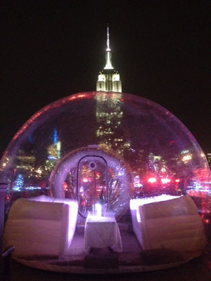 """Transparent bubble tent """"igloos"""" on 230 FIFTH's roof deck weather proof the rooftop bar's spectacular Manhattan views.  (PRNewsFoto/230 FIFTH)"""