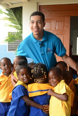 Caption: Sandals Foundation's Youth Advocate Ambassador, Marcus Scribner gets a warm welcome from the students at Seville Golden Preschool in Ocho Rios, Jamaica. This visit was part of his trip to Beaches Ocho Rios A Spa, Golf & Waterpark ResortCREDIT: Beaches Resorts