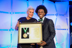 National 4-H Council Legacy Awards: Youth Trustee Lazarus Lynch Presents Food Network Host and New York 4-H Alumna Anne Burrell with the 4-H Legacy Awards Distinguished Alumni Medallion. (PRNewsFoto/National 4-H Council) (PRNewsFoto/NATIONAL 4-H COUNCIL)