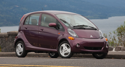 Mitsubishi Motors makes first customer delivery of 2012 Mitsubishi i EV.  (PRNewsFoto/Mitsubishi Motors North America, Inc.)