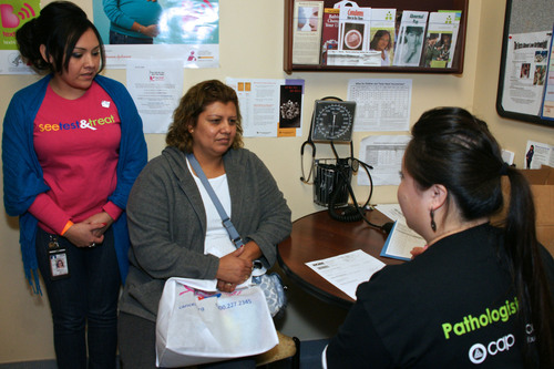 Diana Jimenez receives her Pap test and mammogram results during the See, Test & Treat(R) on Oct. 9-11 at NorthPoint Health & Wellness Clinic, Minneapolis, Minn.  As Dia Xiong, RN, explains the results, NorthPoint employee, Imelda Trevino assists by providing translation services.  The program, funded by a grant from the College of American Pathologists (CAP) Foundation, brings free, same-day cervical and breast cancer testing, diagnosis, and follow-up care to medically underserved women. This patient-centered approach helps ensure that ...