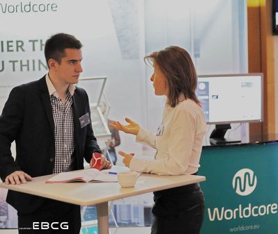A Worldcore executive speaks about the new Worldcore Affiliate Program with a marketer at a recent conference in London