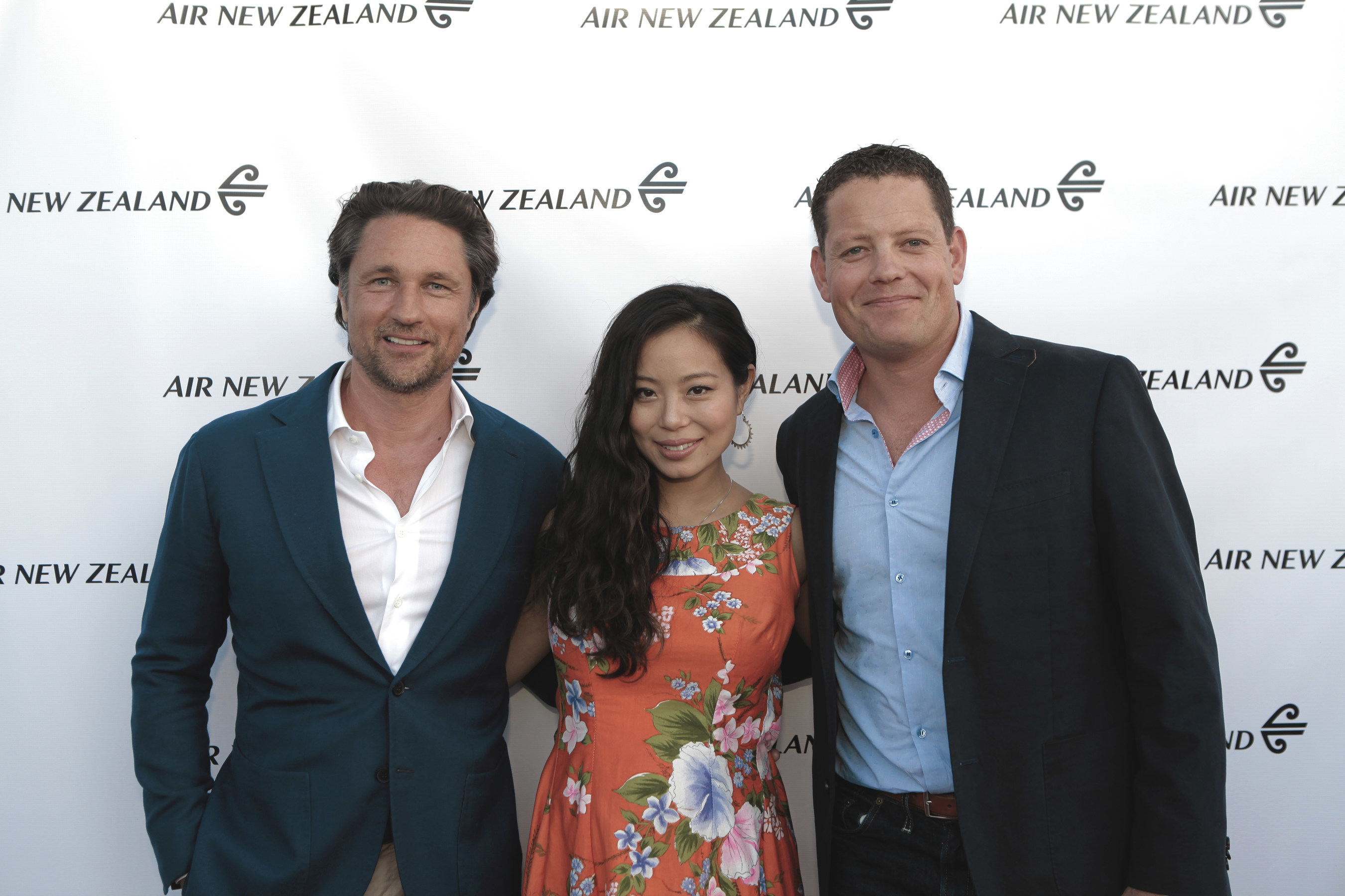 """Kiwi celebrities Martin Henderson and Michelle Ang join Nick Judd, Air New Zealand's Regional General Manager, The Americas, for the airline's red carpet premiere of its newest safety video, """"Safety in Hollywood."""""""