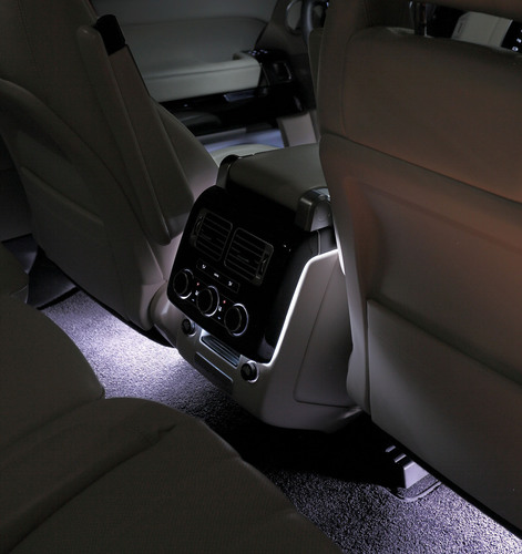 Illumination of the Land Rover Range Rover's rear passenger compartment with ambient interior lighting.  (PRNewsFoto/HELLA)