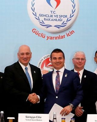 Left to Right - Turkcell CEO Sureyya Ciliv, Minister of Youth and Sports Suat Kilic, World Wide Swimming Coach Bob Bowman
