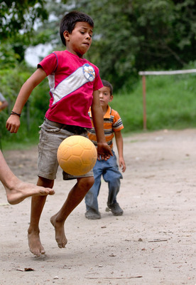 Children play with a new, virtually indestructible football provided by Chevrolet in partnership with the One World Futbol Project Thursday, May 24 in Santa Gertrudis, El Salvador. The collaboration will result in the donation of 1.5 million footballs by Chevrolet to youth in war-stricken zones, refugee camps, disaster areas, and other disadvantaged communities around the word. The automaker's pledge will be fulfilled through a global network of organizations dedicated to helping empower the next generation of footballers. Its support is part of a companywide global football initiative that includes sponsorship of Barclays Premier League giant, Manchester United (Chevrolet News Photo).  (PRNewsFoto/General Motors)