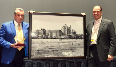 James F. Allen (left) receives the Casino Marketing Lifetime Achievement Award and a framed historical photograph of Atlantic City, N.J., from Charles Anderer (right), Executive Editor of Casino Journal Magazine.  Allen grew up in the area of Atlantic City and began his gaming industry career there.