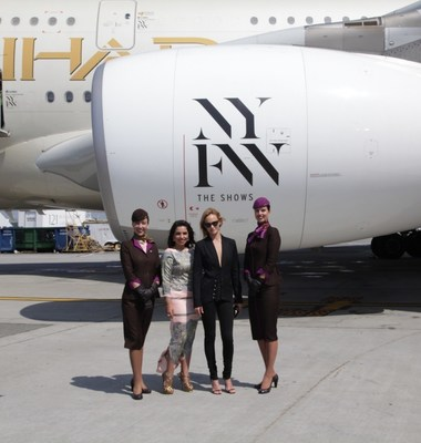 "(From left to right flanked by cabin crew) From runway to runway, Amina Taher, Head of Corporate Communications - Etihad Airways and Supermodel Amber Valletta unveil the airline's A380 livery, featuring an ""NYFW: The Shows""- branded logo on the aircraft engines and doors at JFK International Airport."