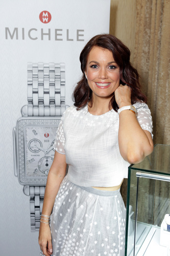 Best Supporting Actress in a Drama Series, Bellamy Young, shows off her MICHELE watch. (PRNewsFoto/MICHELE ...