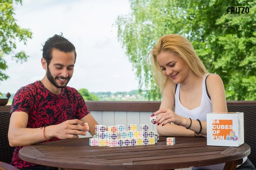Fritzo, a new 3D-Cube that can be played with friends and family. Figure: A shape of 64 cubes. Each player has 32 cubes. Game target: Build as many rows of two and three with your colors as possible. Game duration: 45 minutes. Contents: 64 wooden cubes, rules of the game. Cardboard packaging. (PRNewsFoto/cvasso GmbH)