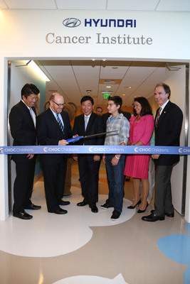 "From left, Mickey Pong, Chairman of the Board, Hyundai Hope on Wheels; Dr. Leonard Sender, Medical Director, Hyundai Cancer Institute; B.H. Lee, Chief Executive Coordinator Hyundai Motor America; CJ George, Hyundai Hope on Wheels Ambassador; Kim Cripe, President and CEO CHOC Children's and Jerry Flannery, Executive VP and General Counsel Hyundai Motor America cut the ribbon during ""Every Handprint Has A Story"" Hyundai Hope on Wheels handprint ceremony at CHOC Children's Hospital on Tuesday, July 23, 2013, in Orange, Calif. (Photo by Ryan Miller/Capture Imaging).  (PRNewsFoto/Hyundai Motor America)"