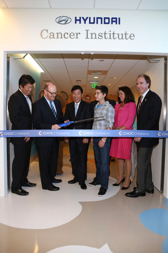 "From left, Mickey Pong, Chairman of the Board, Hyundai Hope on Wheels; Dr. Leonard Sender, Medical Director, Hyundai Cancer Institute; B.H. Lee, Chief Executive Coordinator Hyundai Motor America; CJ George, Hyundai Hope on Wheels Ambassador; Kim Cripe, President and CEO CHOC Children's and Jerry Flannery, Executive VP and General Counsel Hyundai Motor America cut the ribbon during ""Every Handprint Has A Story"" Hyundai Hope on Wheels handprint ceremony at CHOC Children's Hospital on Tuesday, July 23, 2013, in Orange, Calif. ..."